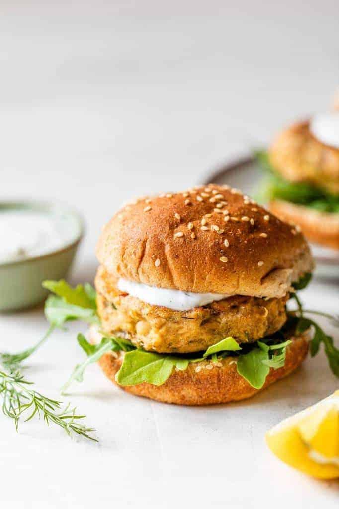 salmon burgers with creamy dill sauce served on a bun