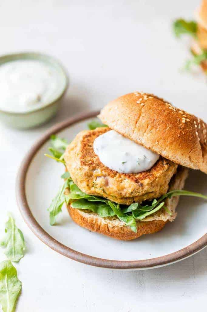 salmon burgers made with canned salmon on a small white plate