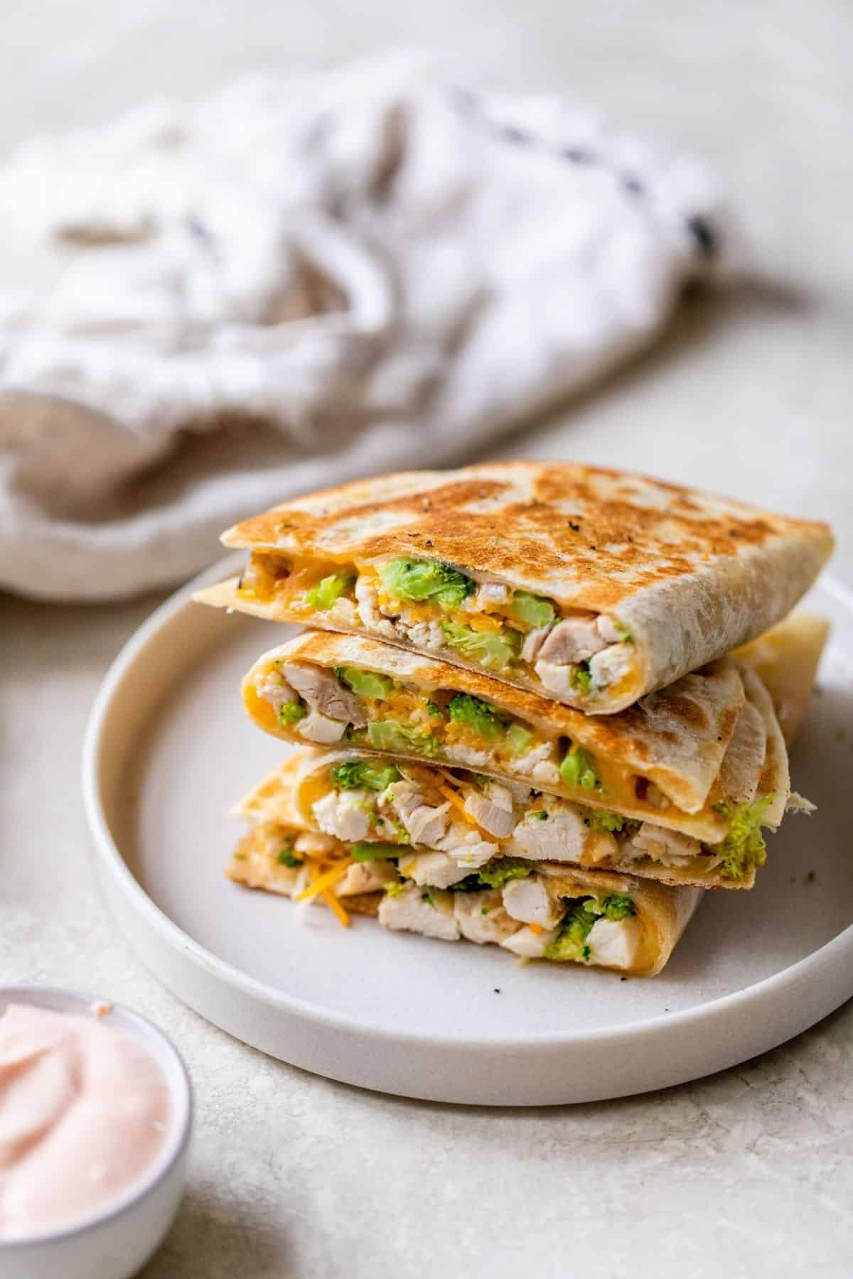 easy quesadillas stacked on a plate