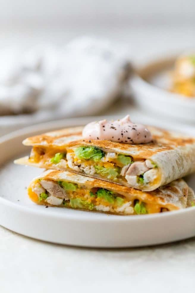 quesadillas served with creamy sriracha dipping sauce on top