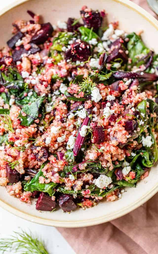 bowl filled with quinoa, beets and greens