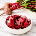 steamed beets in a white bowl