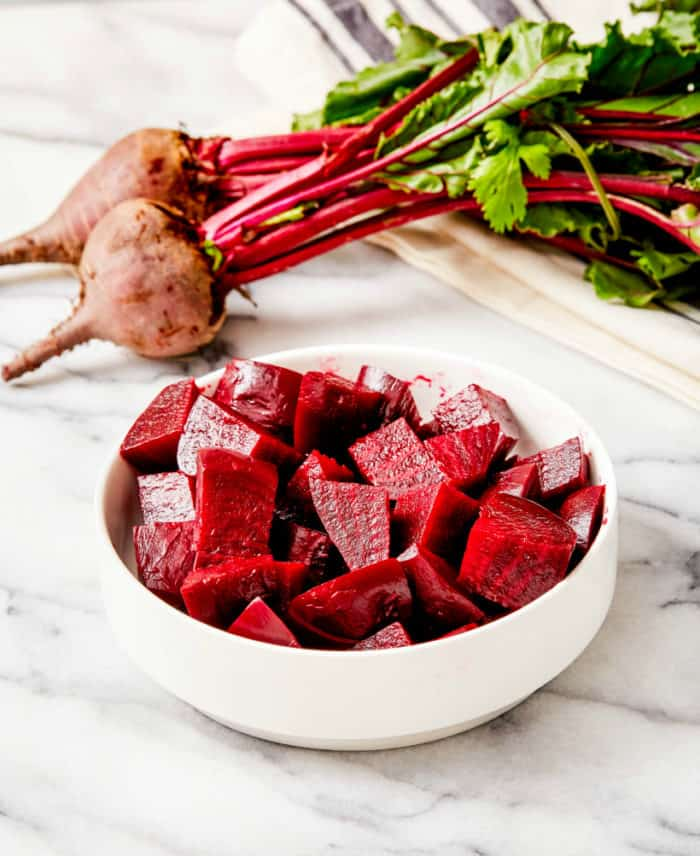 cubed steamed beets in a small white bowl