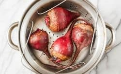 raw beets in a steamer