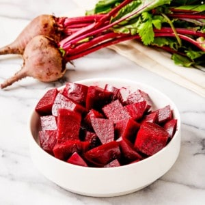 steamed beets in white bowl