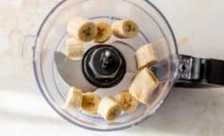 adding frozen bananas to a food processor