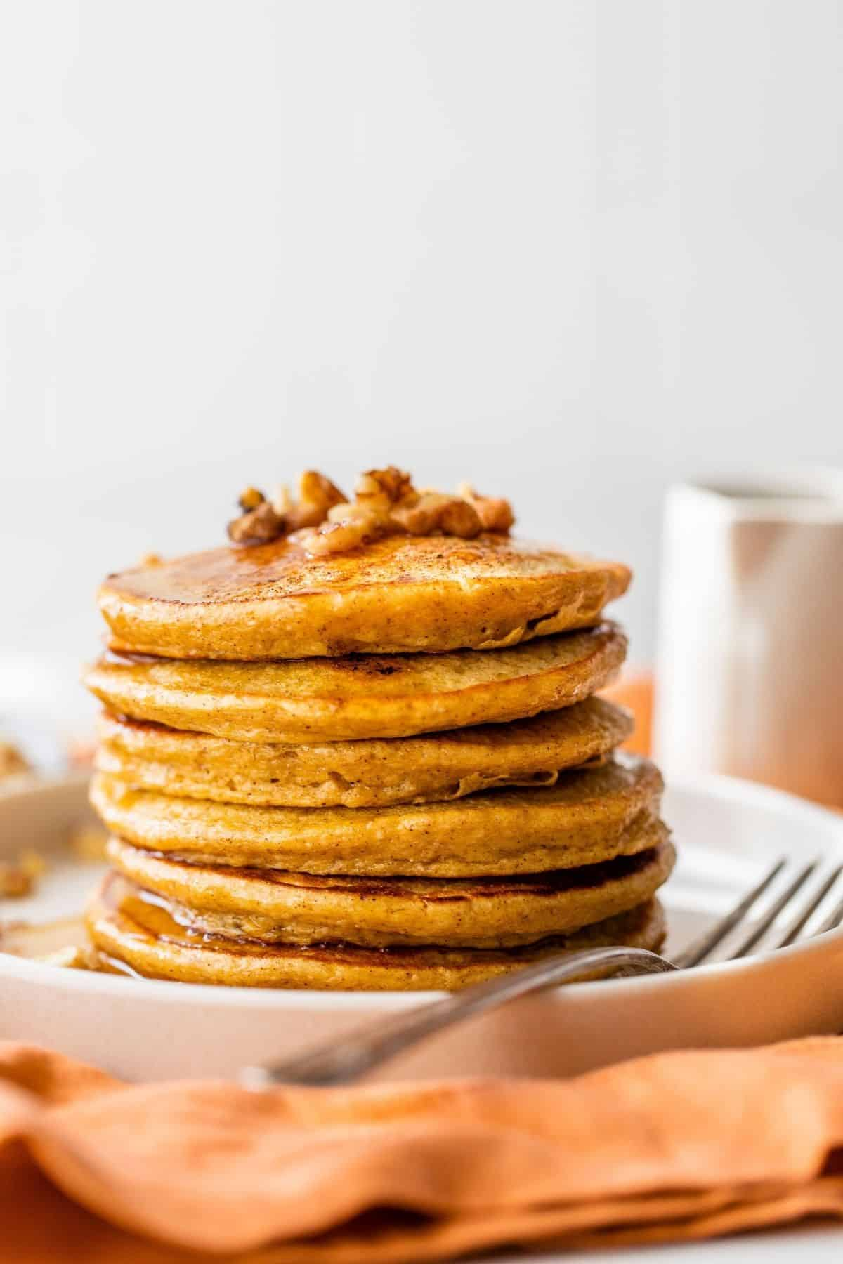 stack of pumpkin pancakes on a small white plate
