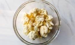 tossing cauliflower with avocado oil