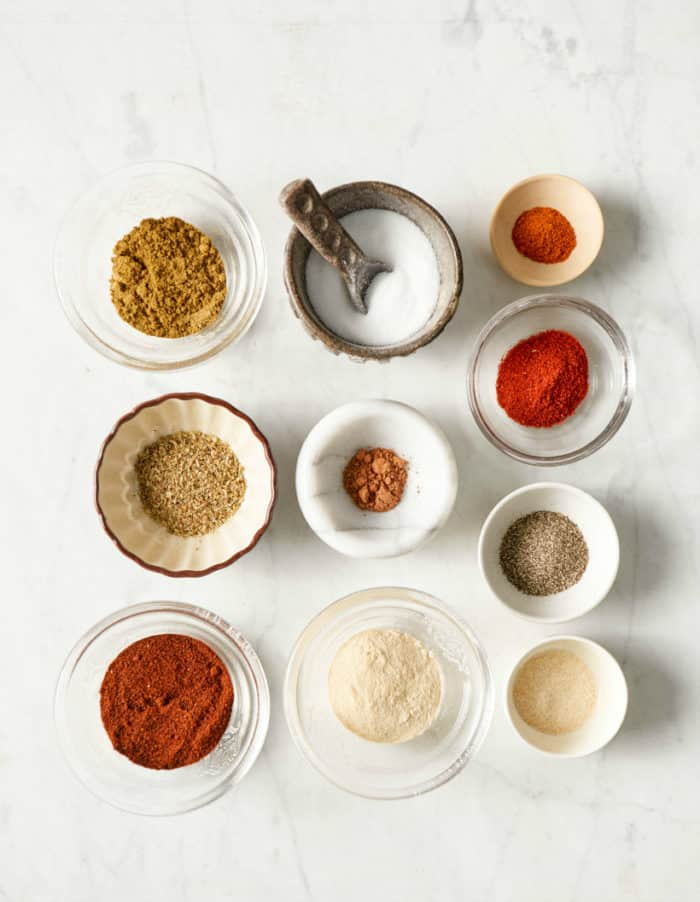 different spices in small bowls