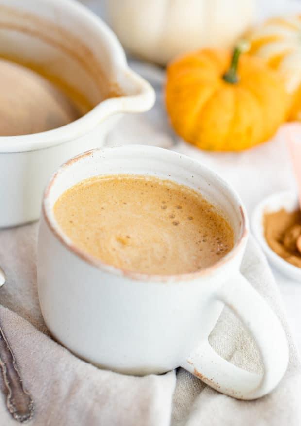 pumpkin spice latte in a mug with fresh cinnamon