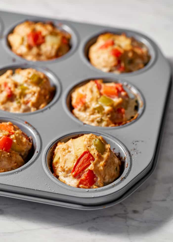 cooked meatloaf muffins in a muffin pan