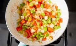 raw veggies cooking in sauté pan