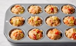 uncooked meatloaf muffins in muffin pan