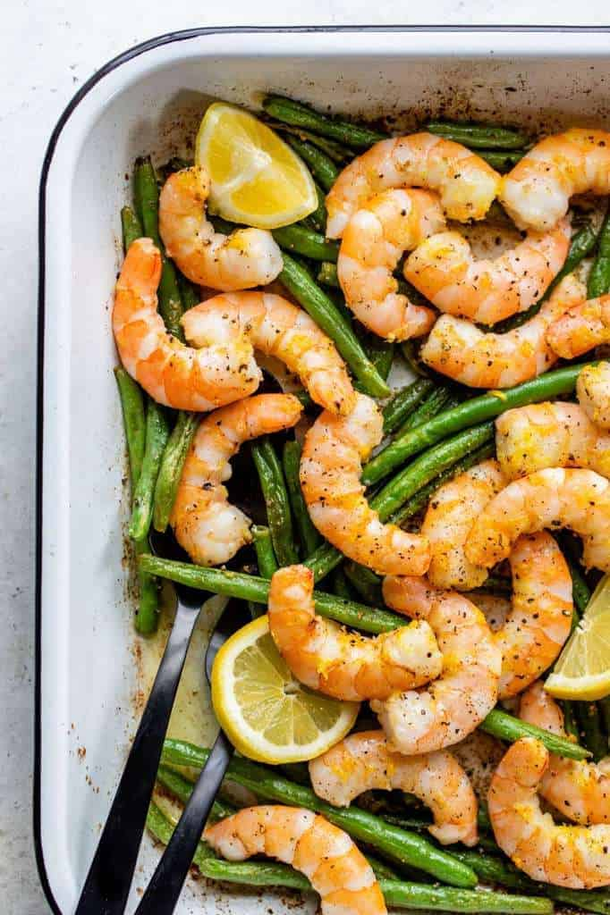 pan filled with shrimp and green beans