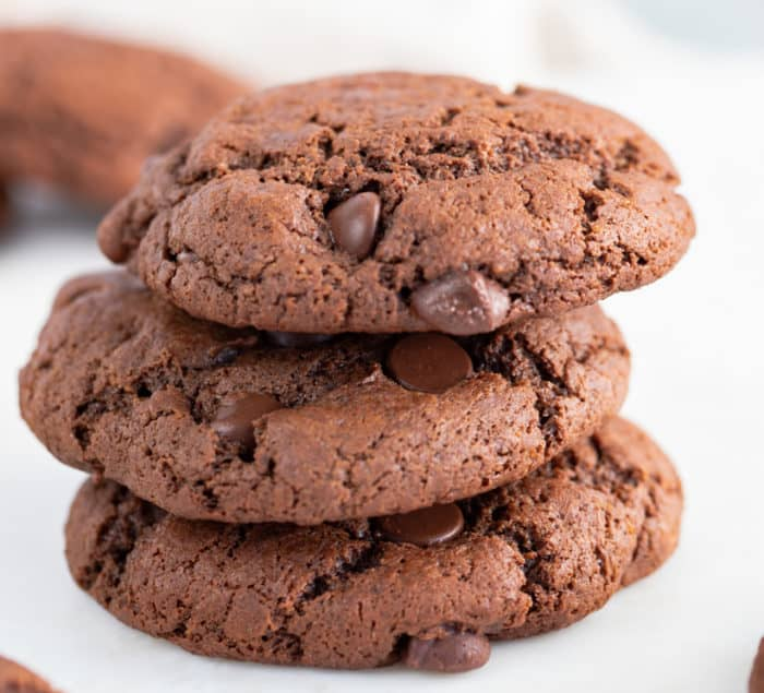 3 stacked double chocolate chip cookies