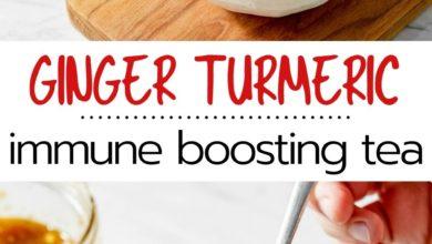 ginger turmeric immune boosting tea made in a white mug