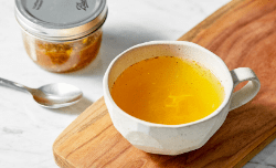 ginger turmeric tea in a white mug