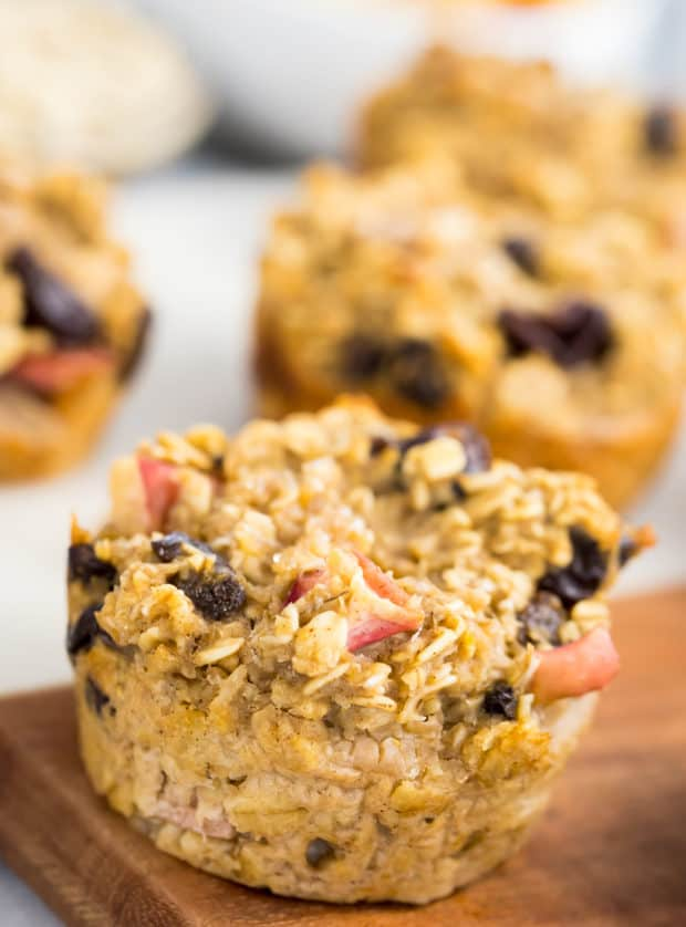apple oatmeal muffins on a wooden cutting board