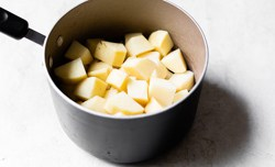 potatoes cut in the pot