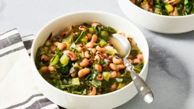 black eyed peas and collard greens in white bowl