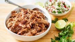 shredded kaluha pork in bowl with salsa