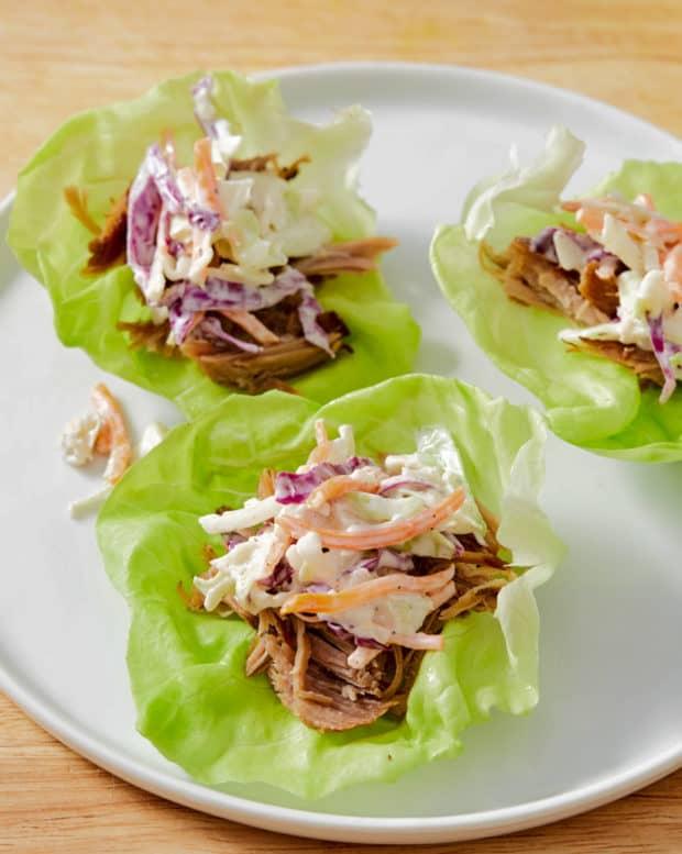kalua pork lettuce wraps topped with slaw