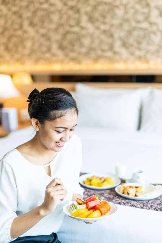 girl eating fruit plate