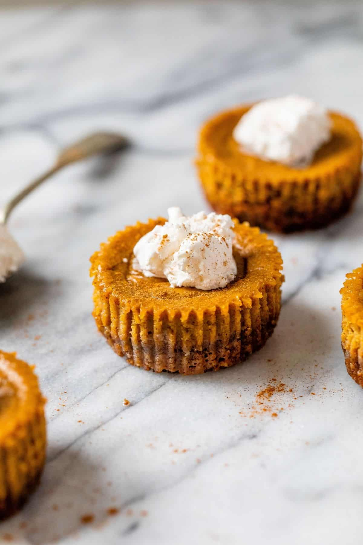 mini pumpkin pie topped with whipped cream