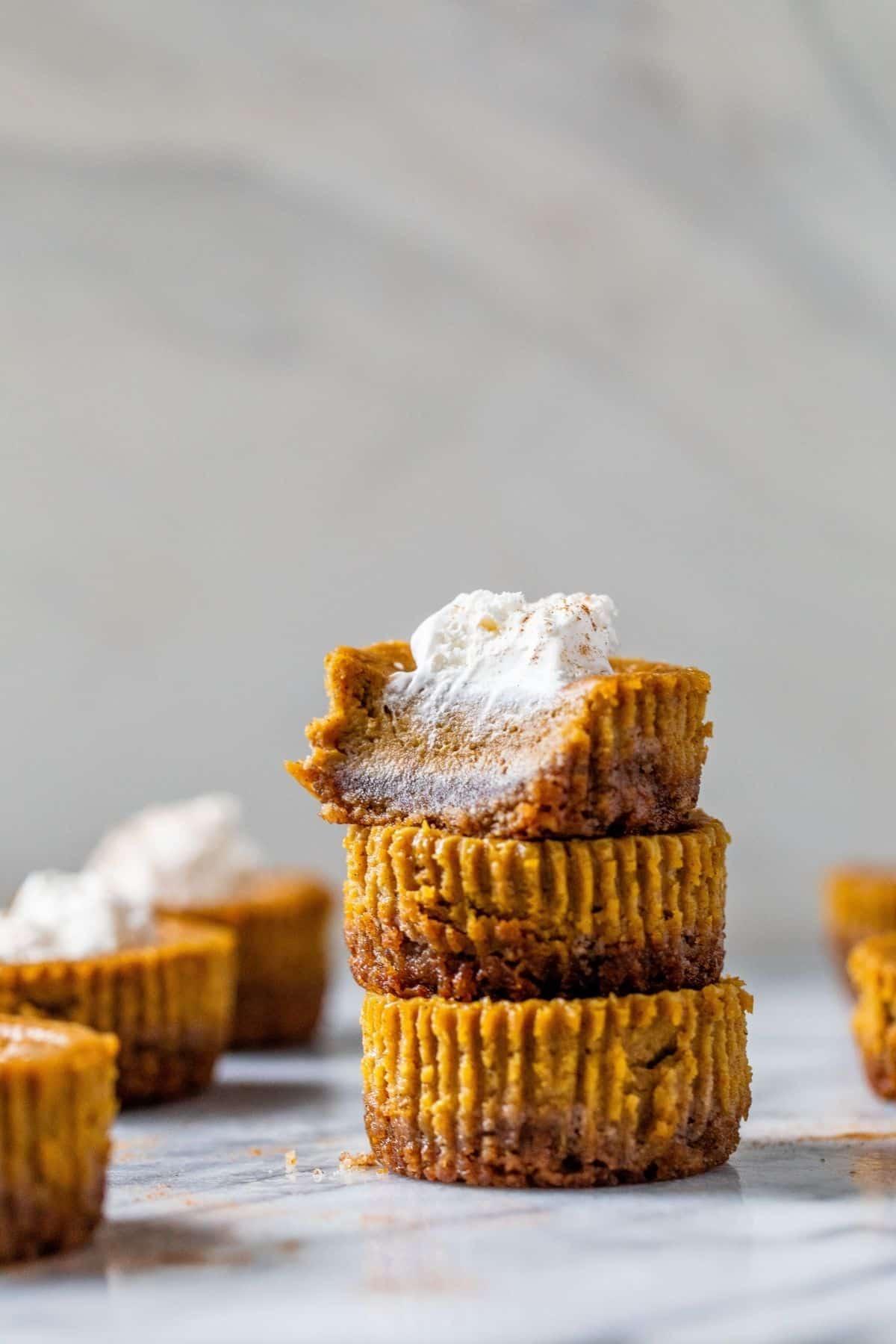 three mini pumpkin pies stacked