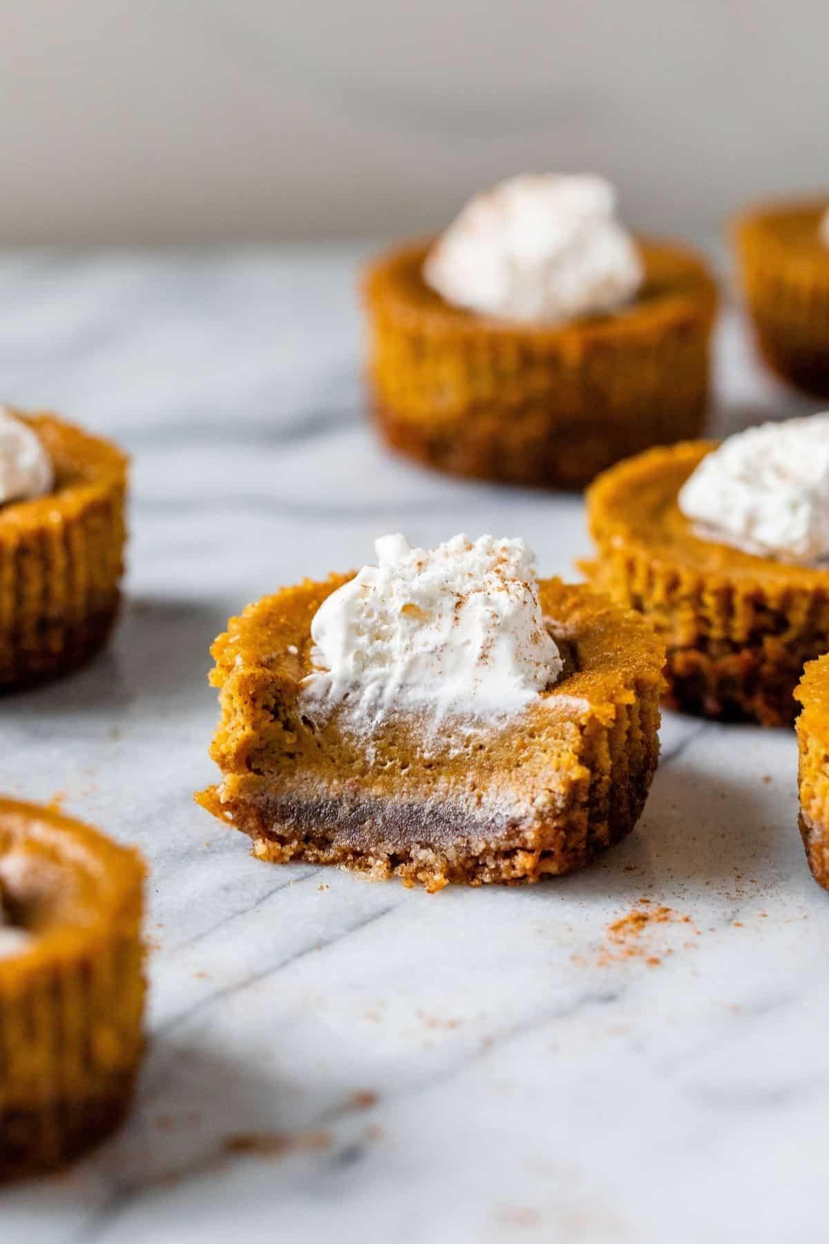 mini pumpkin pie with a bite taken out