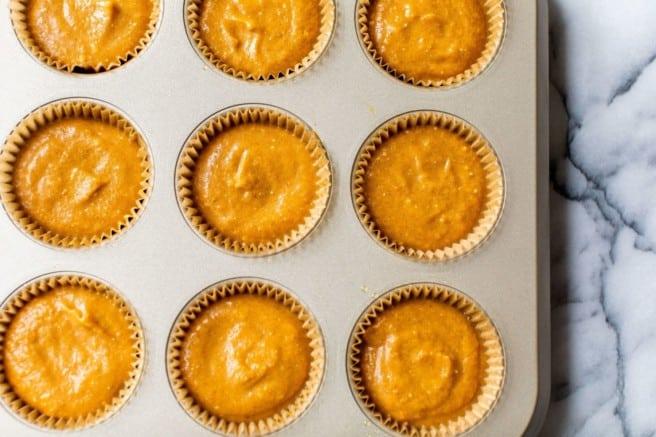 pumpkin filling in a muffin pan