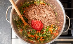 tomato paste and broth added to pot