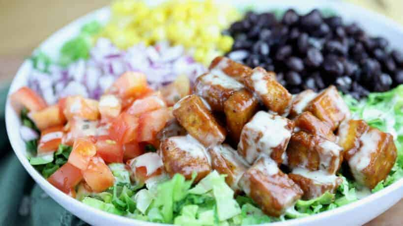 romaine lettuce topped with corn, black beans, tomatoes, red onion and bbq tofu