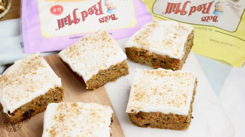 gluten free carrot cake with cream cheese frosting cut into squares