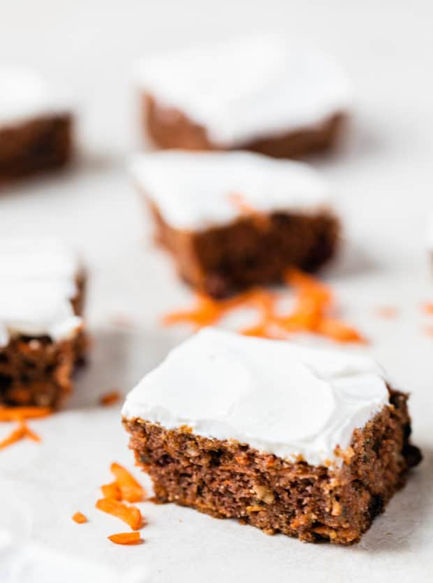 slices of gluten free carrot cake with cream cheese frosting