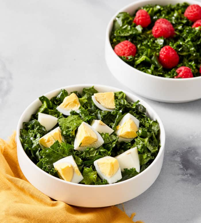kale salad with eggs and berries