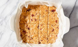 peanut butter oat bars cut into 16 squares