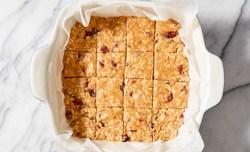 peanut butter oat bars cut into 16 squares