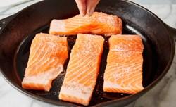 seasoning salmon in cast iron skillet