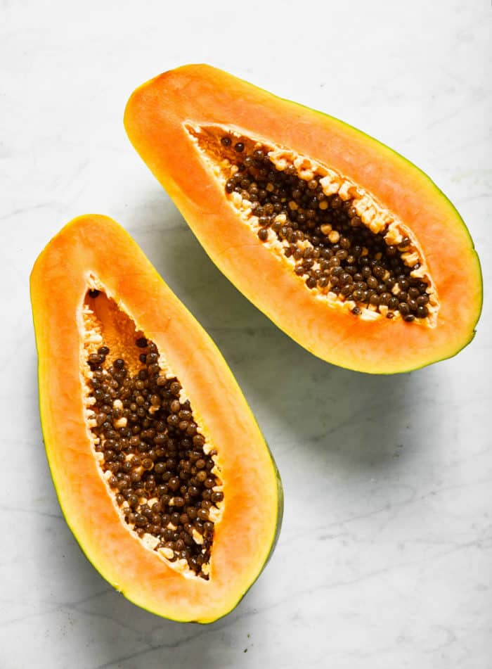 open papaya with seeds