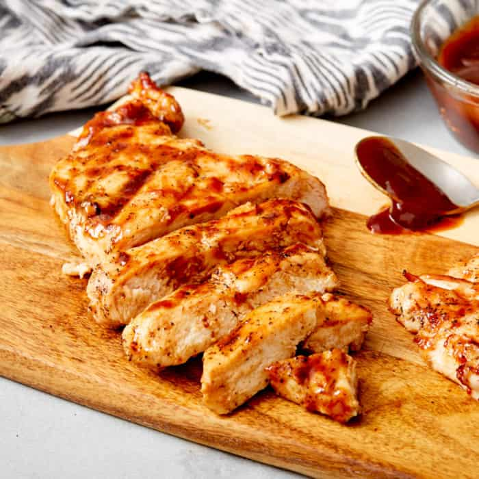chicken breast on cutting board