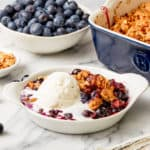 warm blueberry crisp with vanilla ice-cream