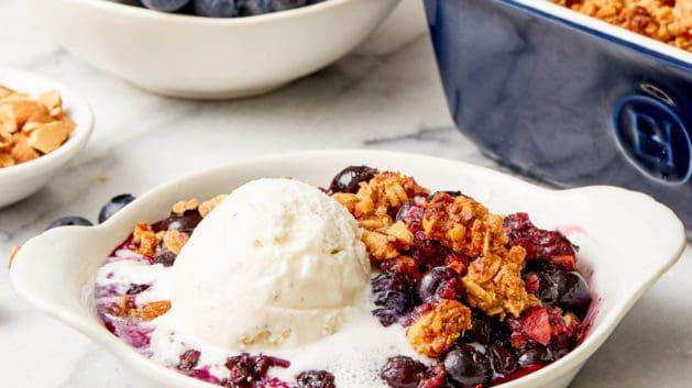 warm blueberry crisp with vanilla ice-cream