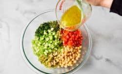 pouring dressing into cauliflower salad
