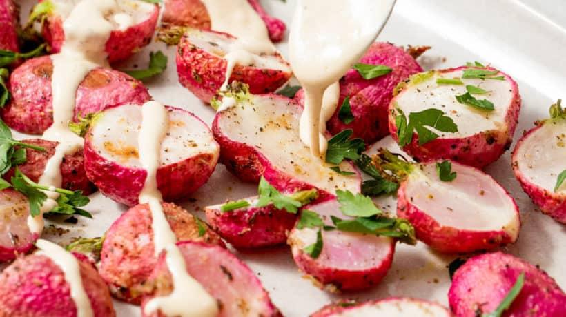 roasted radishes drizzled with lemon tahini sauce