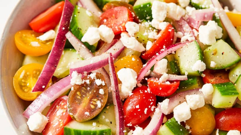 tomato cucumber and onion salad tossed in a vinaigrette