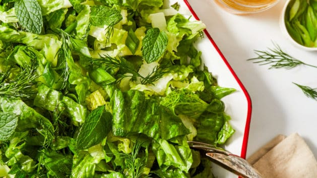 romaine lettuce salad with dressing and fresh herbs