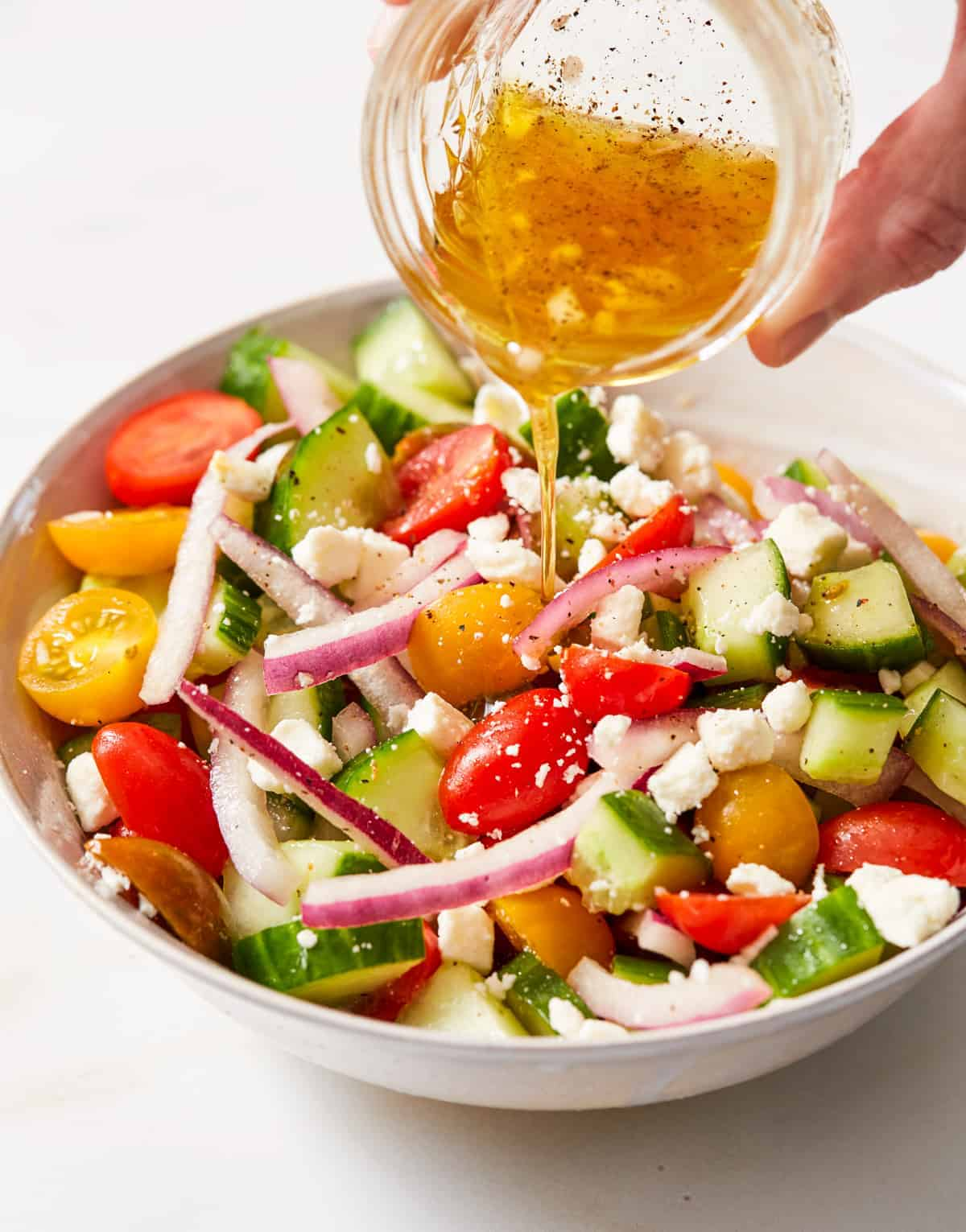 cucumber tomato onion salad drizzled with a light vinaigrette