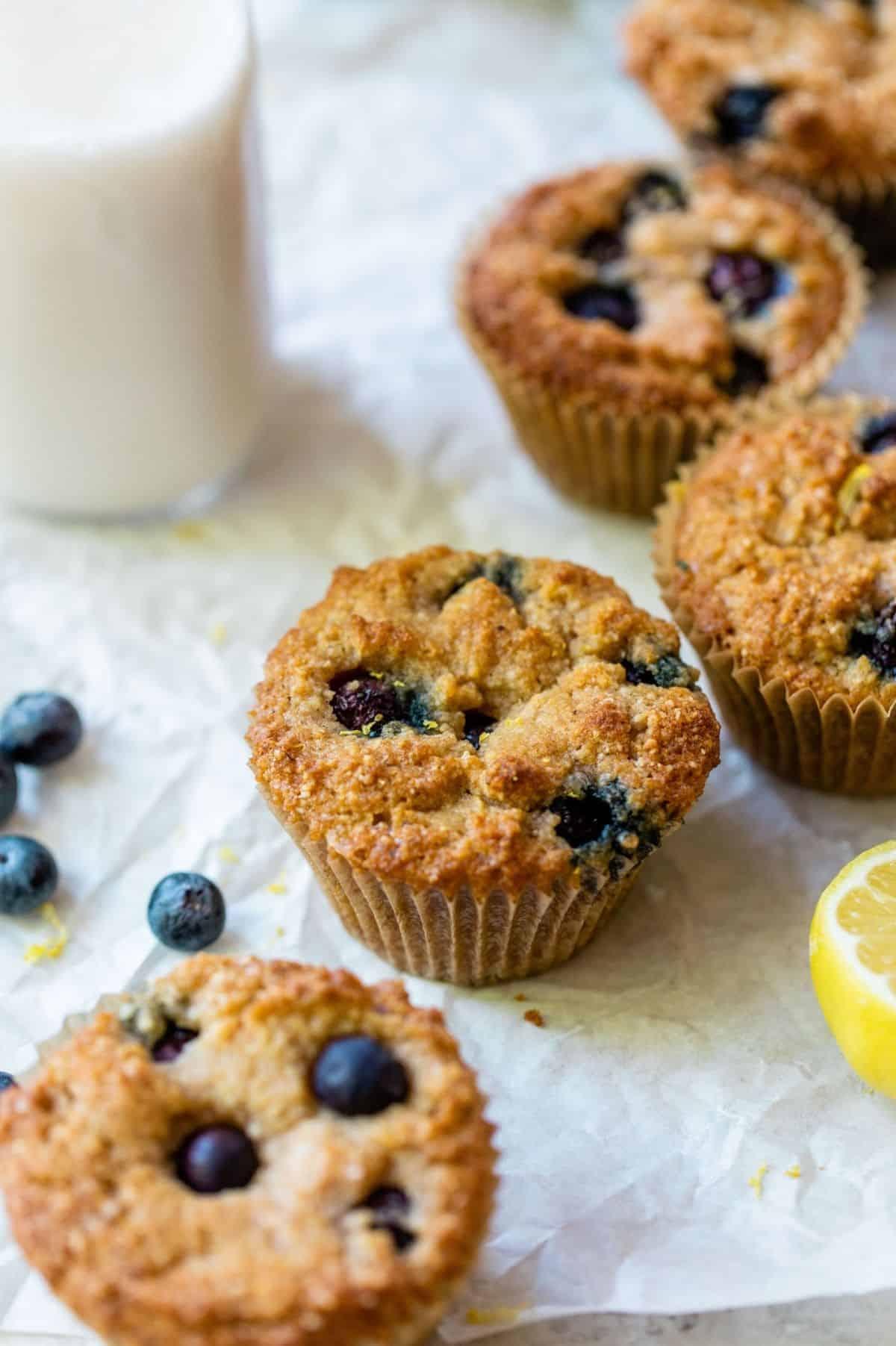 muffins near fresh blueberries and lemon