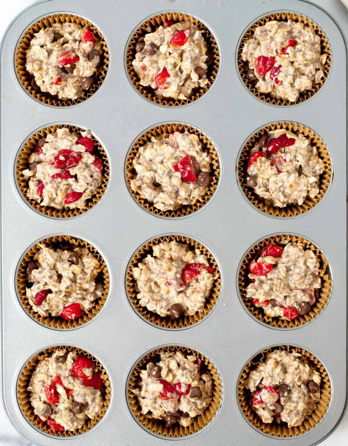 Cherry oat muffins in muffin pan